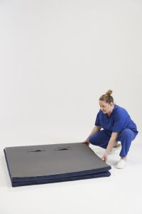 Birthing floor mat and midwife