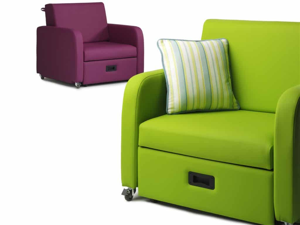 Green hospital chair that turns into a bed, purple sleeper chair behind