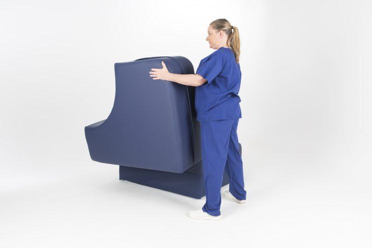 Midwife using birthing furniture