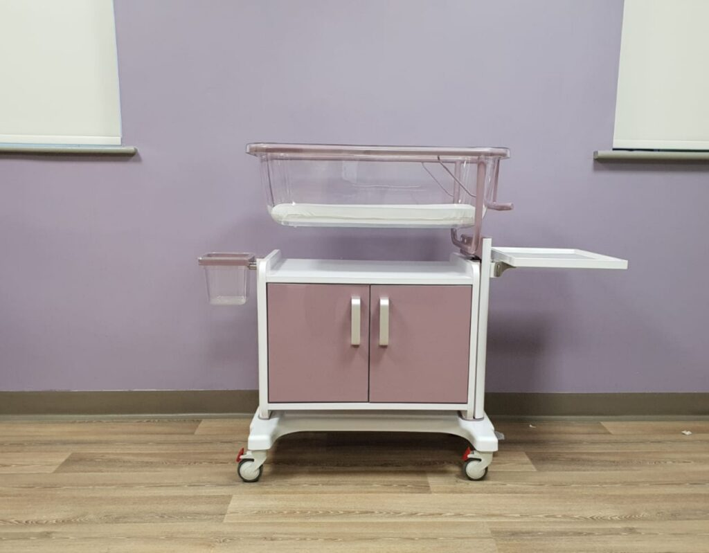 Purple baby crib for hospital with added storage