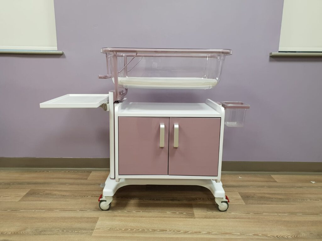Purple hospital height adjustable cot with cupboard