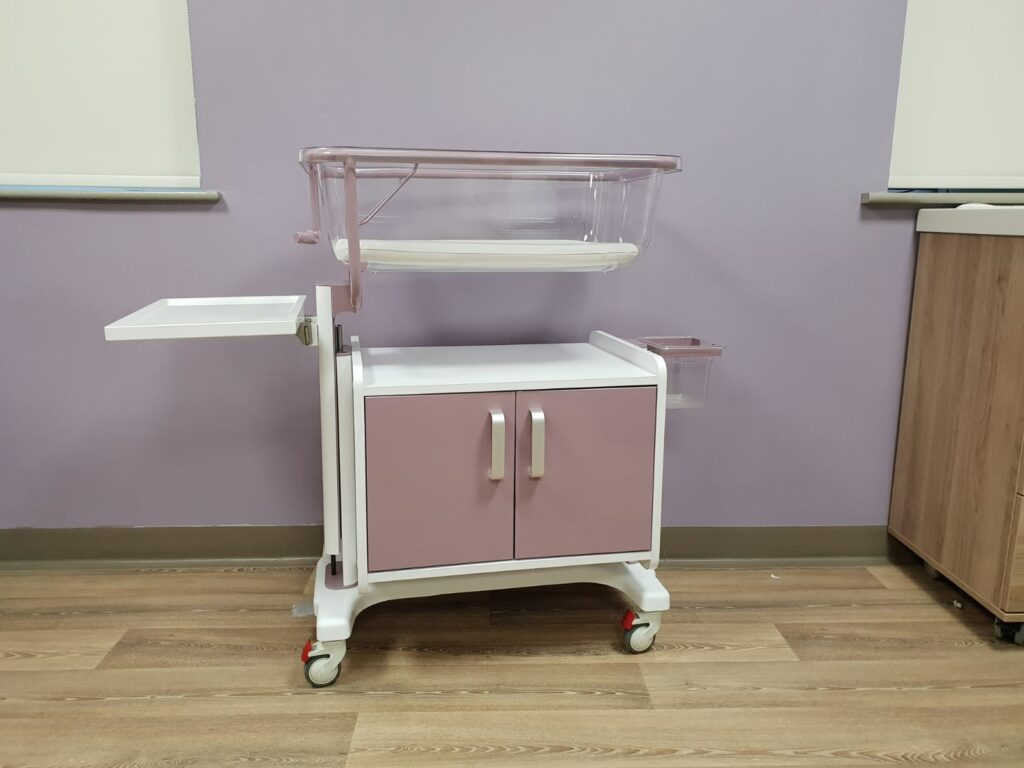 Purple variable height cot with storage